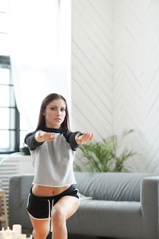 Home fitness, woman exercising