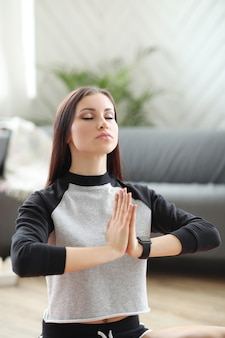 Home fitness, woman meditating