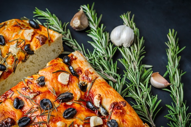 Home focaccia with olives and rosemary