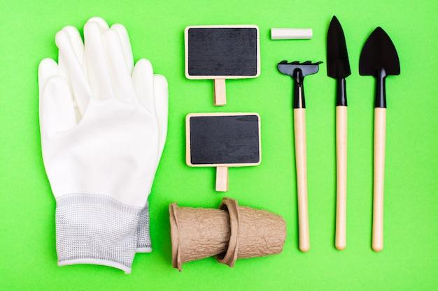 Home gardening. miniature gardening tools: scoop, rake, inscription board, gloves and chalk