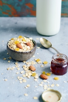 Home granola in a bowl and jam in a bottle