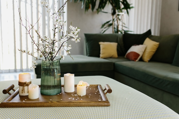 Home interior. relaxing candles. apple tree color has flown