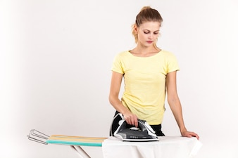 Home ironing woman board young