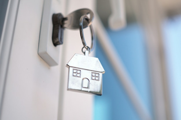 Home key for unlocking the new house door. renting, buying, selling houses