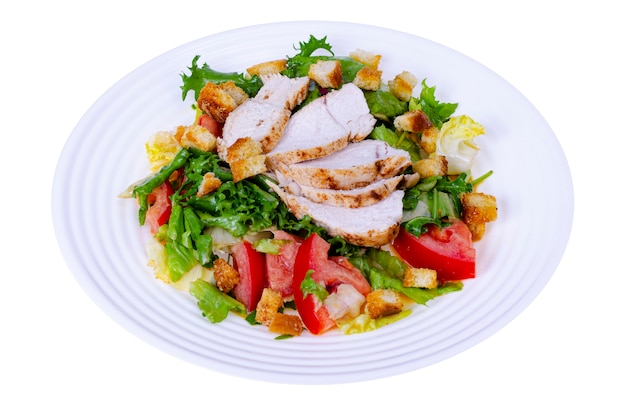 Home kitchen. vegetable salad with chicken and croutons. caesar.