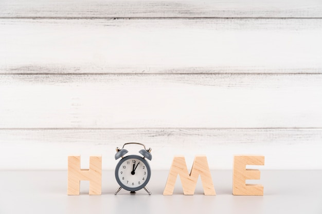 Home lettering with wooden letters and clock