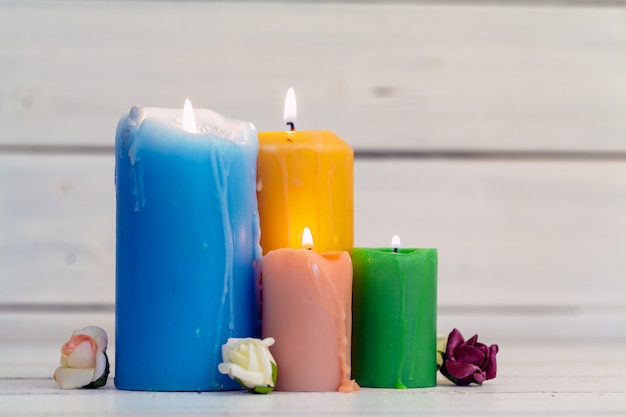 Home lighting candles on wooden surface table