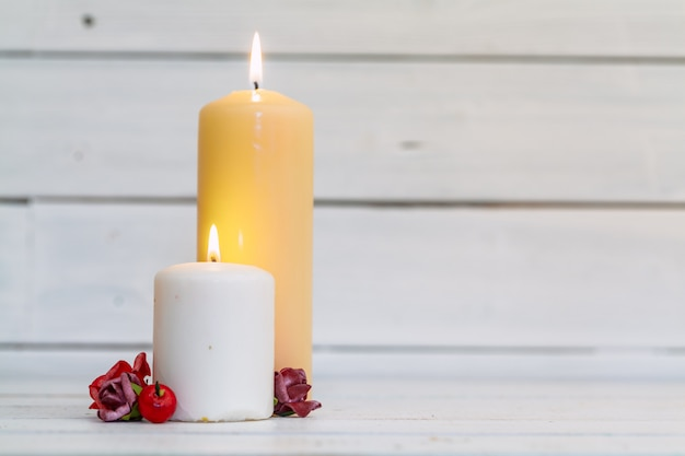 Home lighting candles on wooden table