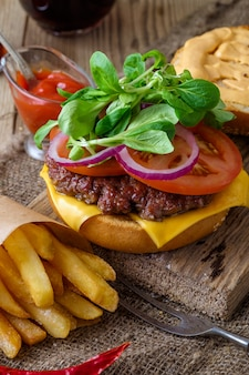 Home made burger and chips on wooden