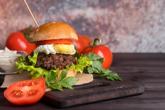 Home made burger with delicious tomatoes