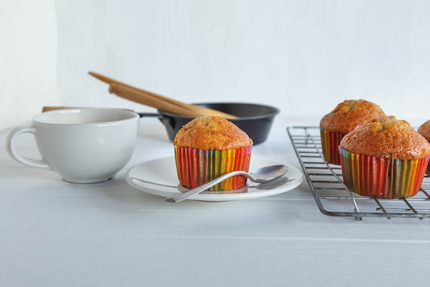 Home made cupcakes and coffee cup on white table