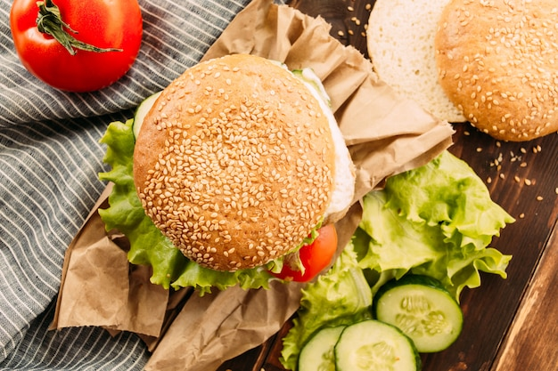 Home made fastfood burgers on rustic background