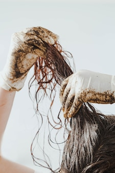 Home made hair treatment with mud