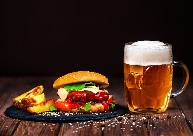 Home made mouth watering, delicious beef burger with lettuce and beer