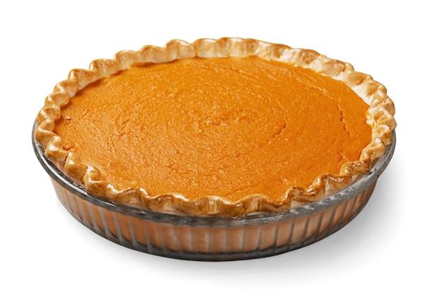 Home made pumpkin pie on white background.