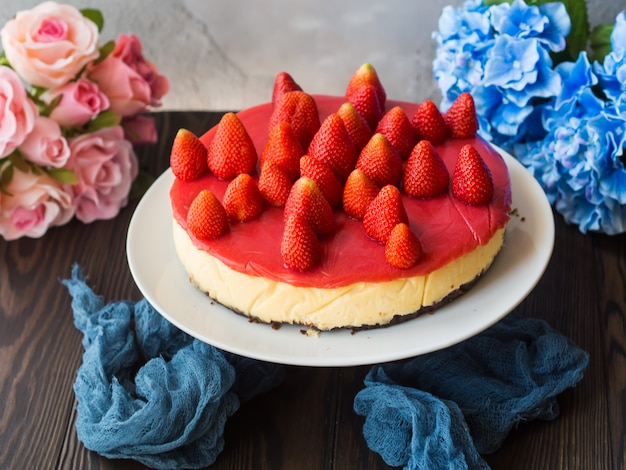 Home made strawberry baked cheese cake on gray