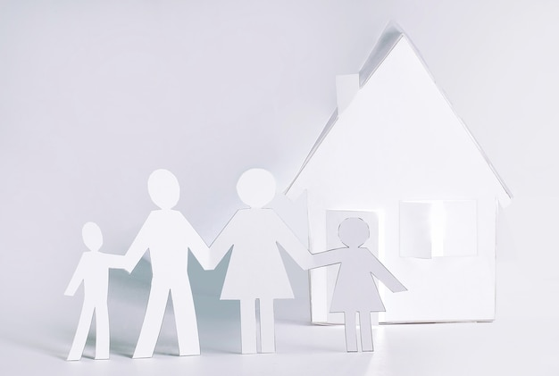 Home and men made of paper.the concept of a mortgage.photo with copy space