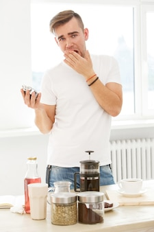 Home, morning. man with coffee cup