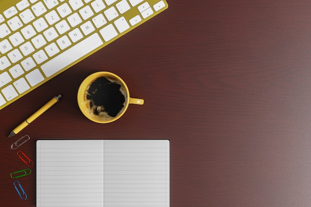Home office desk with notebook, yellow pen, yellow keyboard and yellow cup of coffee on red wood table. top view flat lay with copy space.