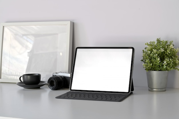 Home office mockup tablet with smart keyboard on minimal white workspace table.