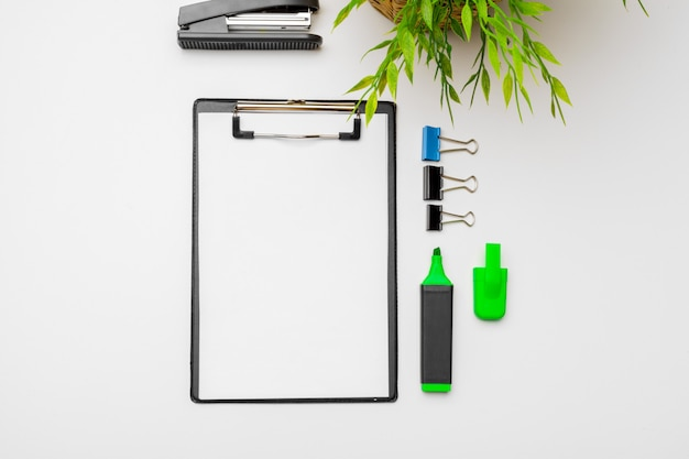 Home office workspace  with  green plant and stationery accessories with copyspace . flat lay, top view