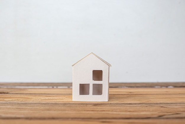 Home protecting insurance concept ,paper house, family home