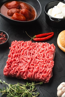 Home raw minced beef meatball burgers ingredients set, on black stone table