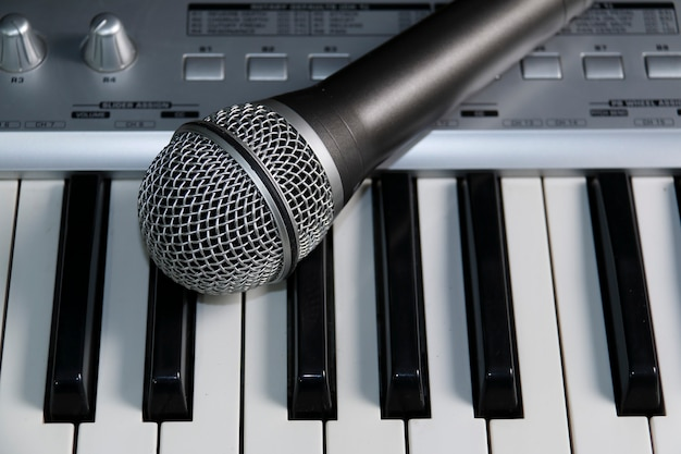 Home recording studio. microphone on a keyboard.