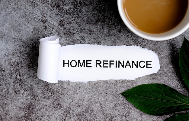 Home refinance with cup of coffee and green leaf