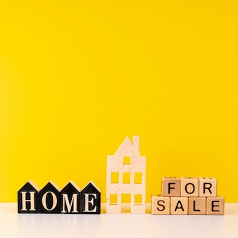 Home for sale lettering on yellow background