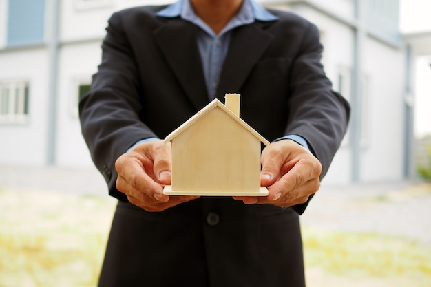 Home sales representatives hold house designs for buyers.