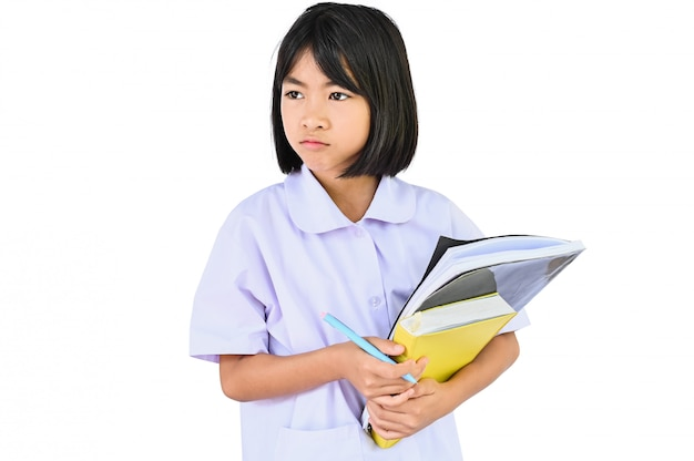Home school concept, asian children holding pile books looks at them questioningly and does not want to study