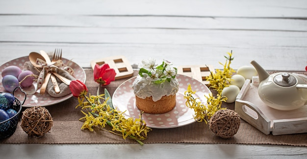 Home table setting for easter holiday. the concept of a family holiday and decor.
