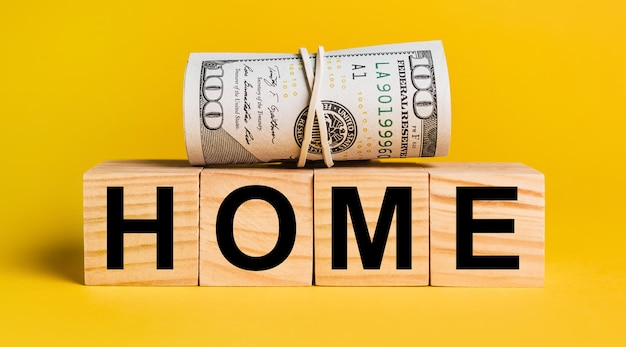 Home with money on a yellow background. the concept of business, finance, credit, income, savings, investments, exchange, tax