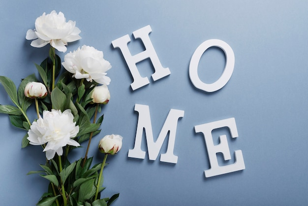 Home wooden word with white peonies