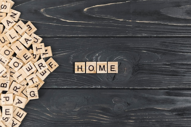 Home word on wooden background