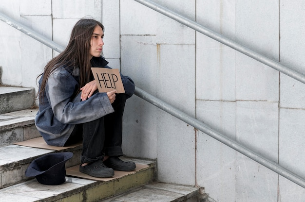 Homeless man begging for help