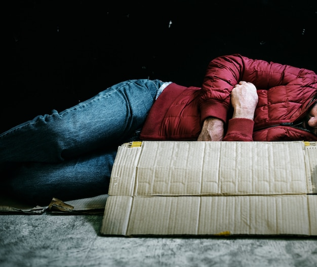 Homeless man sleeping out in the cold