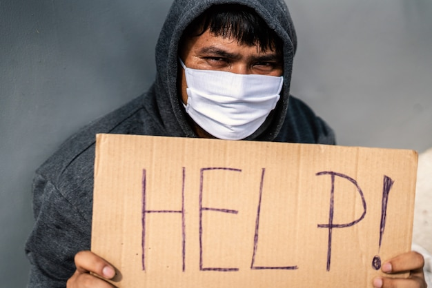 Homeless man unemployed on the street due to corona virus covid 19 and need help