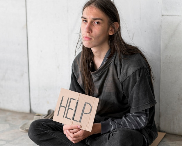 Homeless person begging for help
