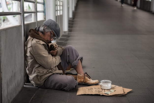 Homeless sleep and hold beer bottle