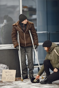 Homeless in a winter city. man asking for food