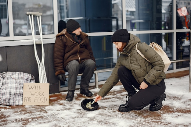 Homeless in a winter city. man asking for food.