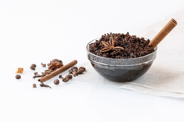 Homemade anti-cellulite scrub with ground natural coffee, cinnamon and other spices