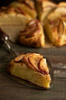 Homemade apple cinnamon scones on vintage cake spatula on wooden table