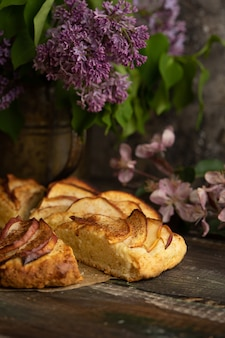Homemade apple cinnamon scones with lilac flowers and apple blooming branches