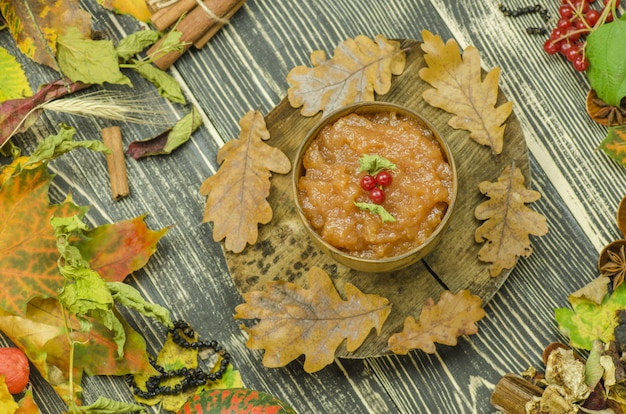 Homemade apple jam on a wooden background