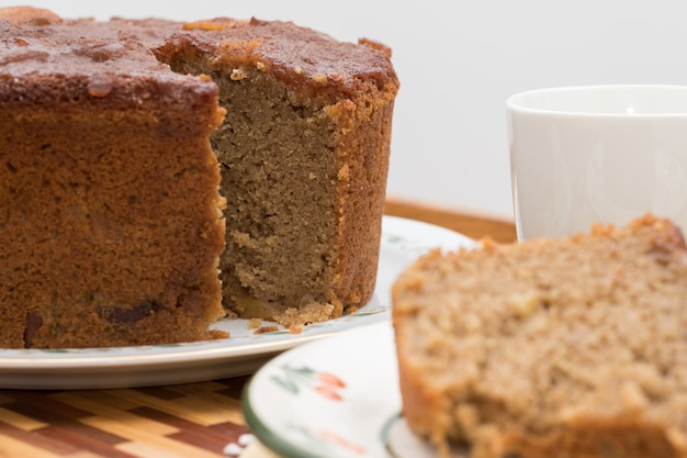 Homemade apple and nuts wholemeal flour cake and cup of coffee