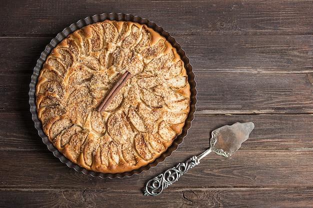 Homemade apple pie on a dark rustic background