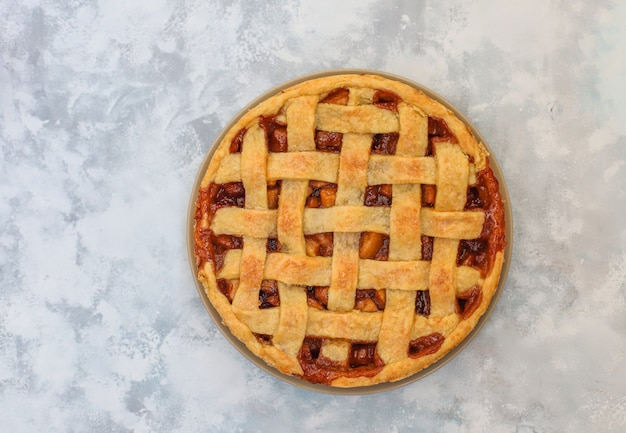 Homemade apple pie on grey concrete background,top view